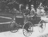 Nelson and Milton Good riding their automobile